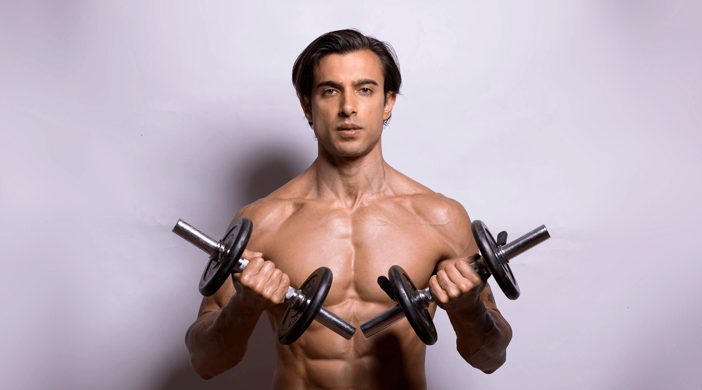 Lean and ripped man holding weights