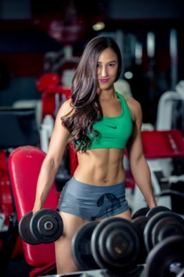 Women in gym with heavy weights