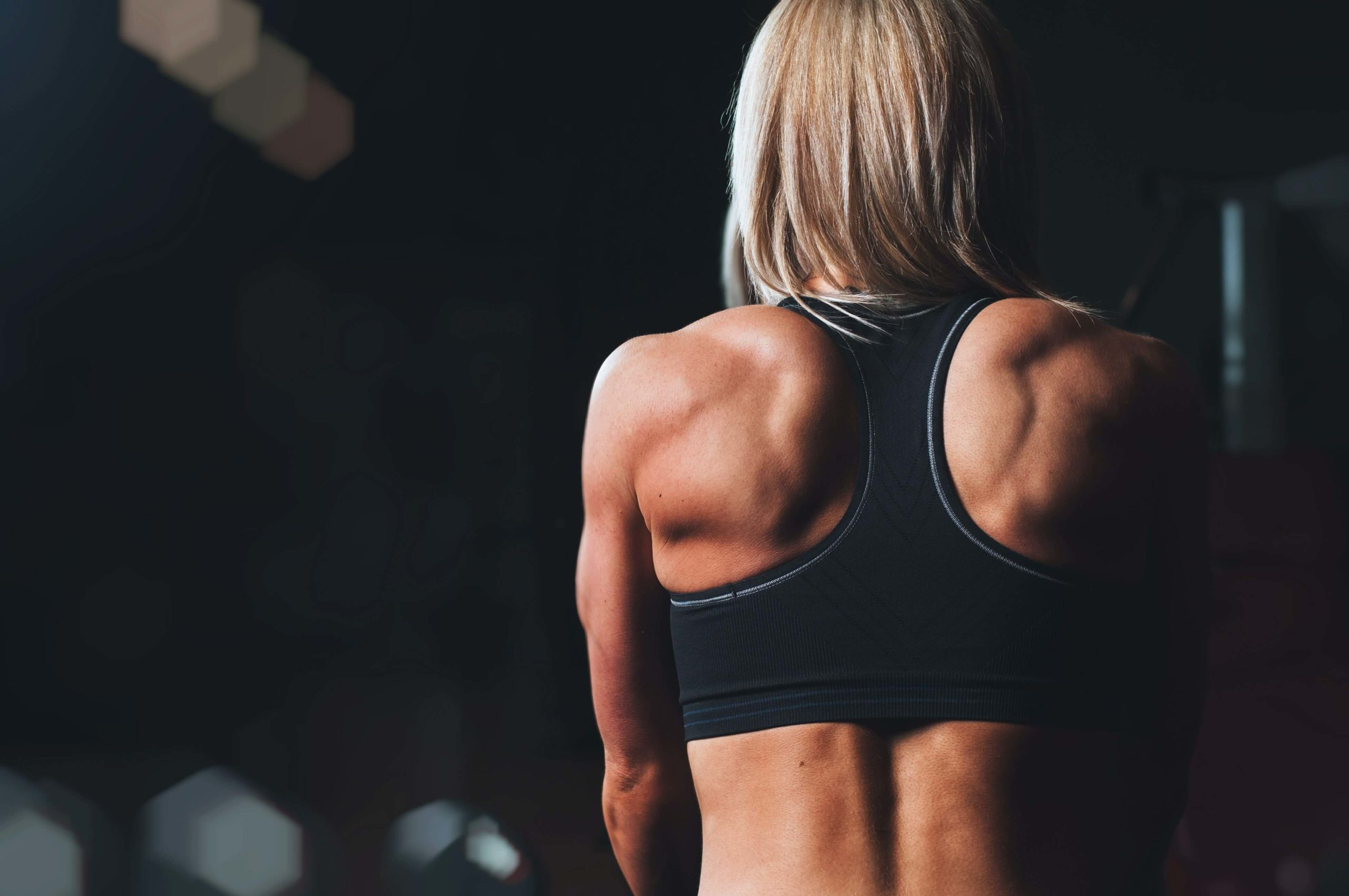 Female physique with training. Female back shot.
