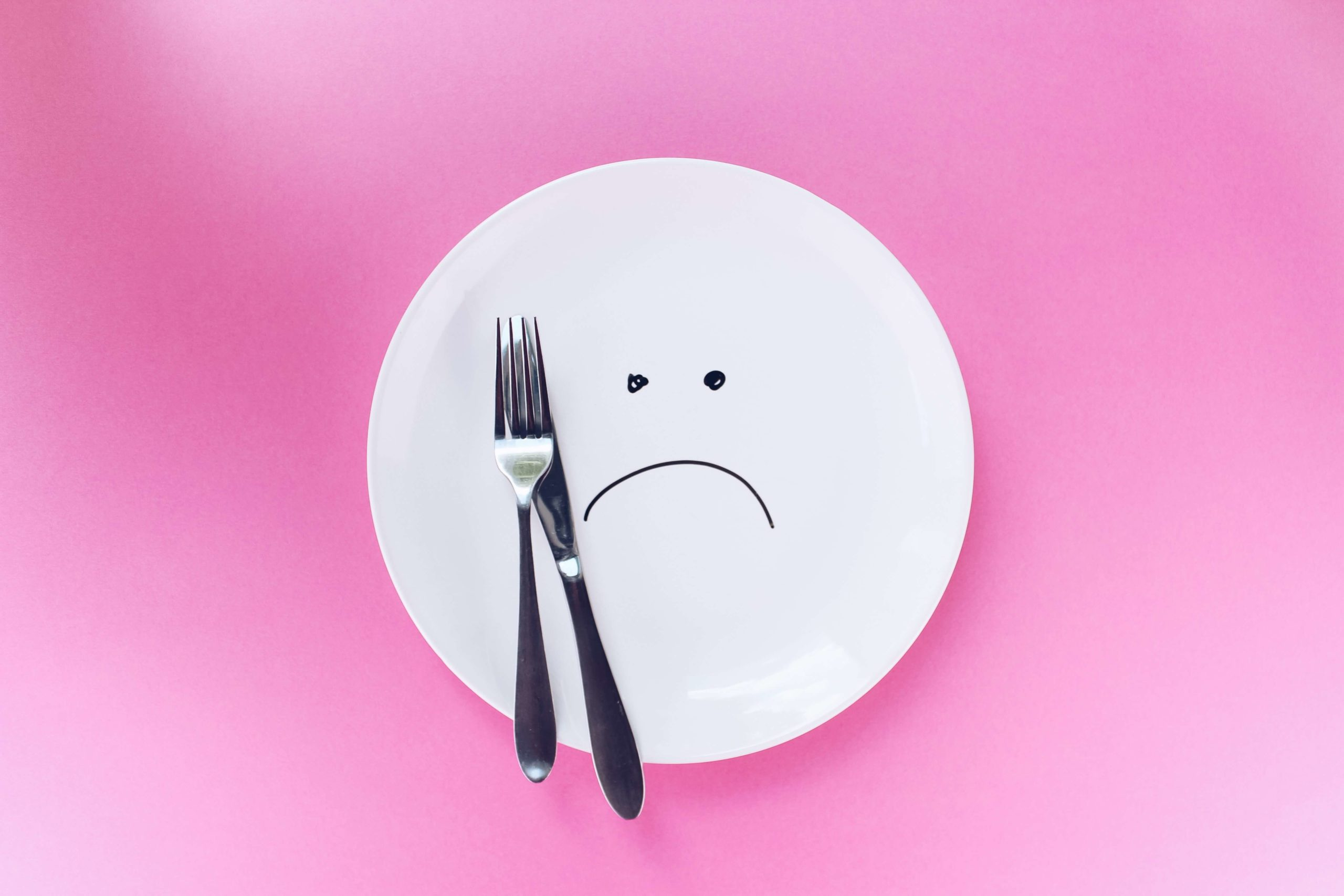 Fad diet. Plate with sad face on it